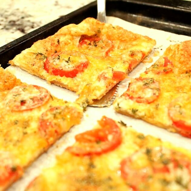 Tomato Cheddar Tart after baking, on cookie sheet
