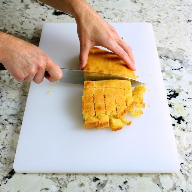 Cutting up cornbread for turkey stuffing
