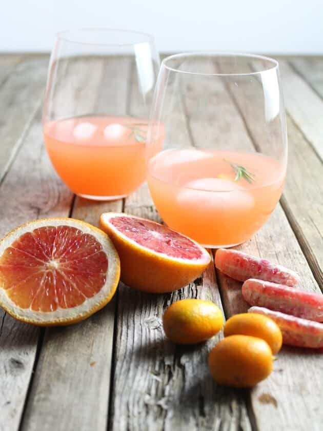 Two glasses of Aperol Punch with citrus fruit