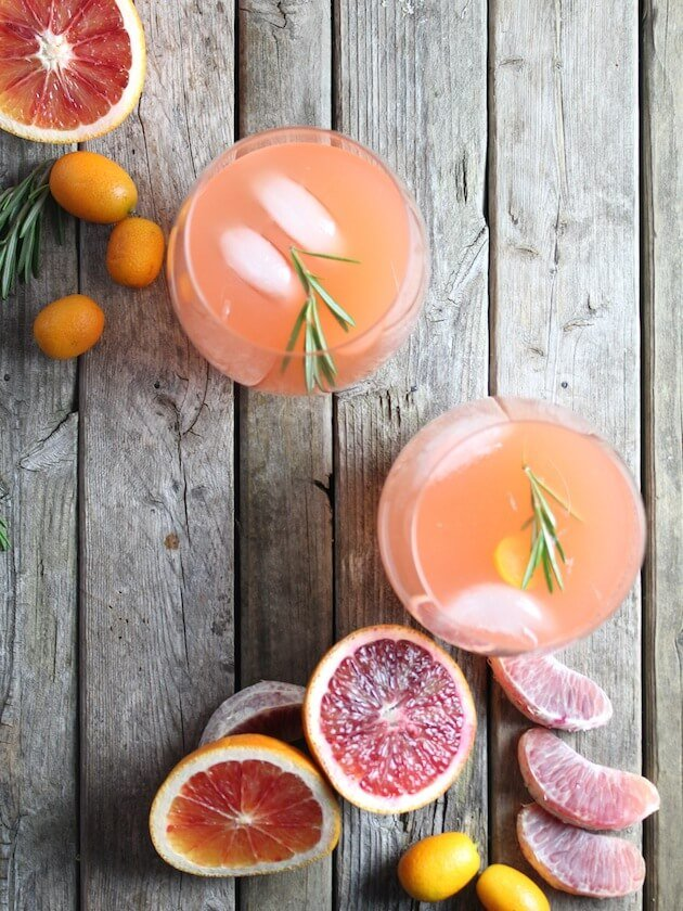 Fruity cocktail in two glasses on farm table