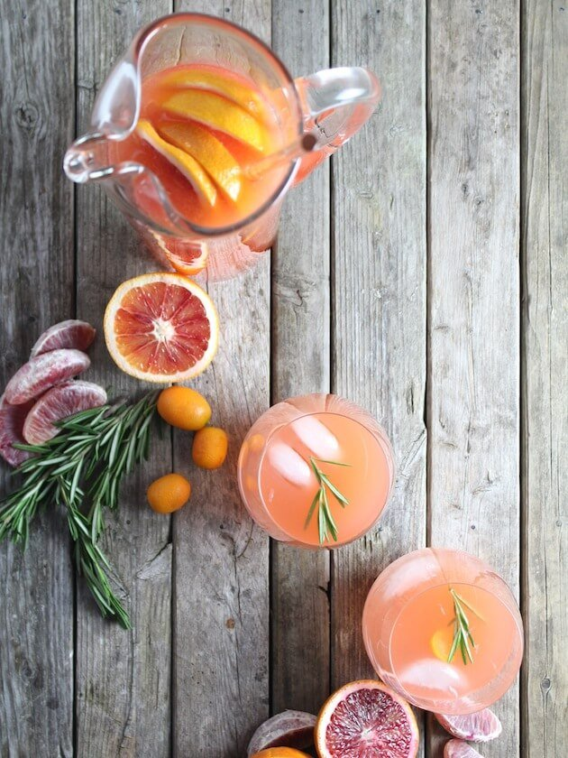Aperol Punch Pitcher with grapefruit, blood orange, and rosemary