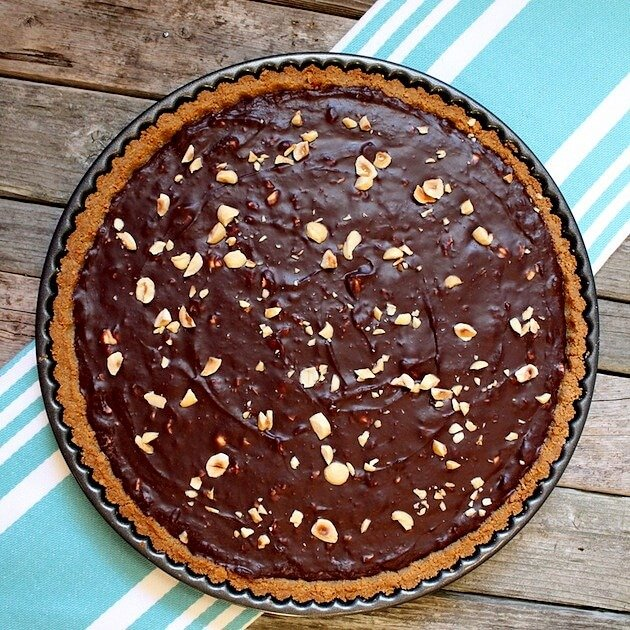 Chocolate Hazelnut Tart on blue cloth