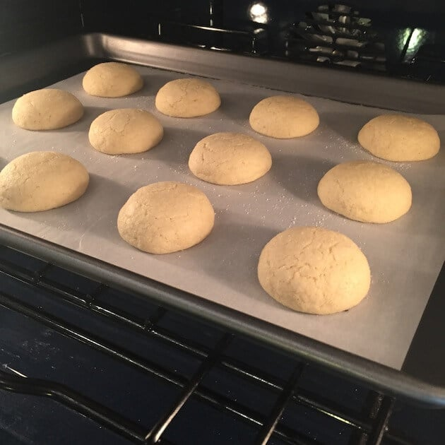 Sugar Cookies baking on a cookie sheet in the oven