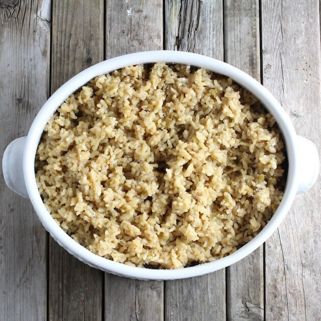Creamy Parmesan Risotto in a serving dish on a farm table