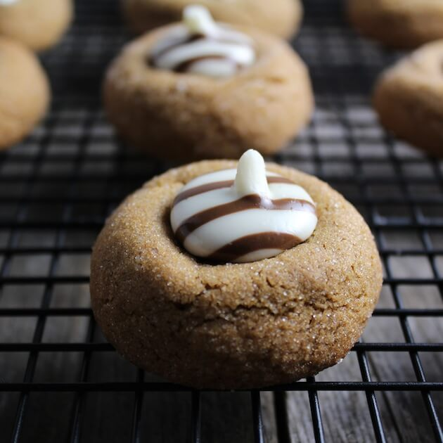 Gingerbread Thumbprint Cookies with white chocolate centers, on a wire cooling rack