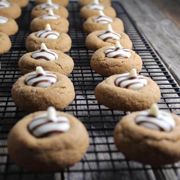 White Chocolate Kissed Gingerbread Thumprint Cookies on a wire cooking rack