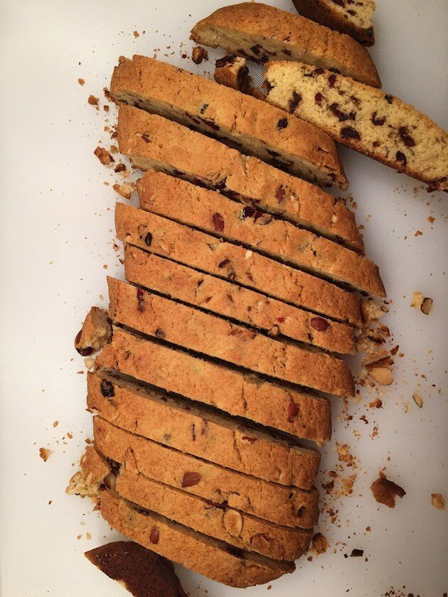 Holiday biscotti sliced on a cutting board after being baked