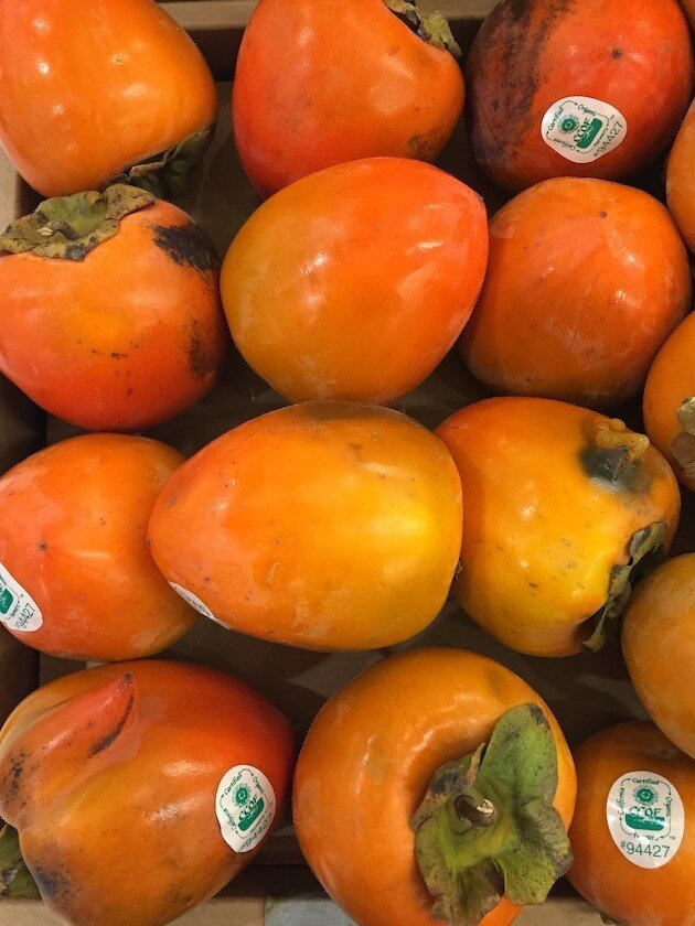 persimmons and procuitto in store