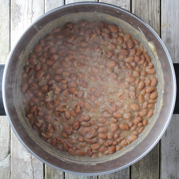 Steam hot pinto beans in a soup pot