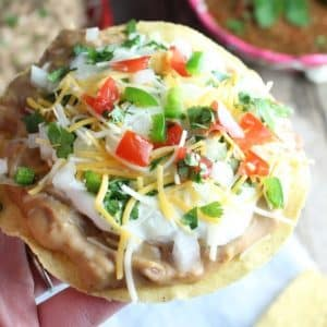 Crunch corn Tostata with refried beans and toppings