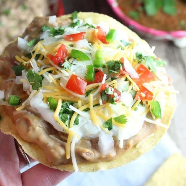 Crunchy Mexican Pizza with sour cream, jalapeno, tomato, sour cream
