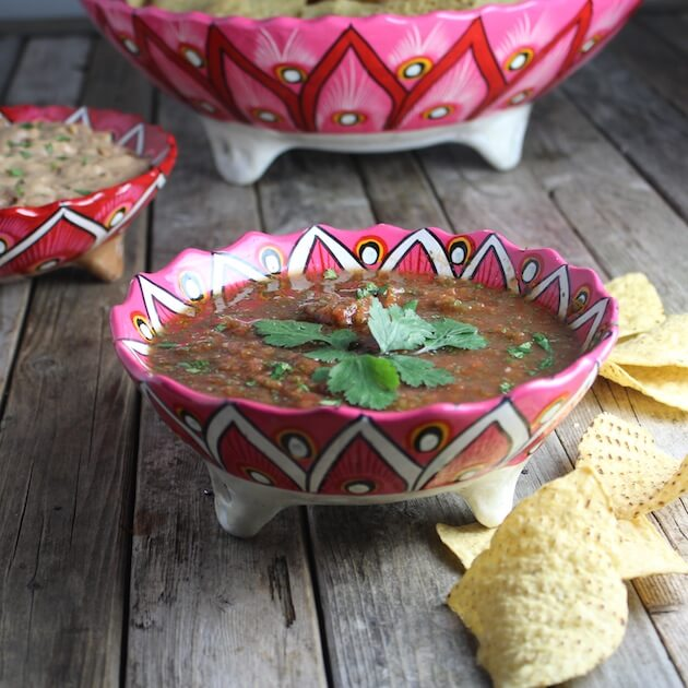 Bowl of Salsa with corn chips on table