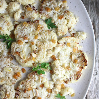 Cauliflower With Asiago Cheese And Golden Raisins