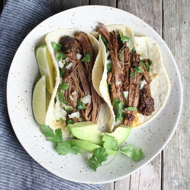 Two Slow Cooker Beef Barbacoa Tacos on a plate
