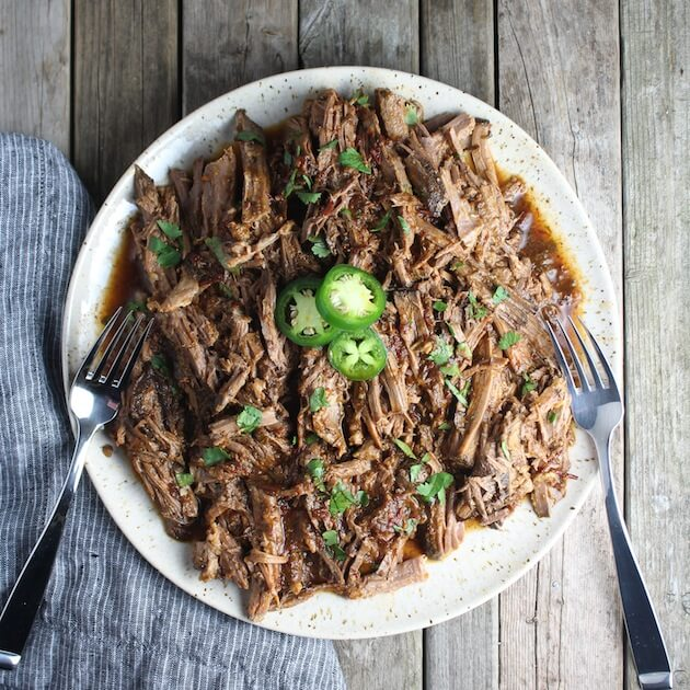 Slow Cooker Beef Barbacoa pulled on a plate