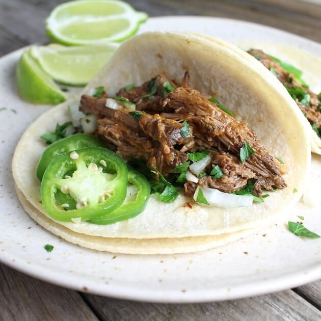 soft taco with slow cooked beef, jalapenos, and lime