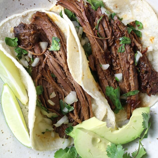 Two beef tacos with avocado
