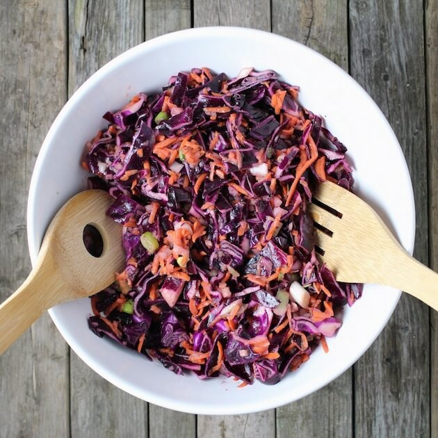 Cabbage slaw in white mixing bowl