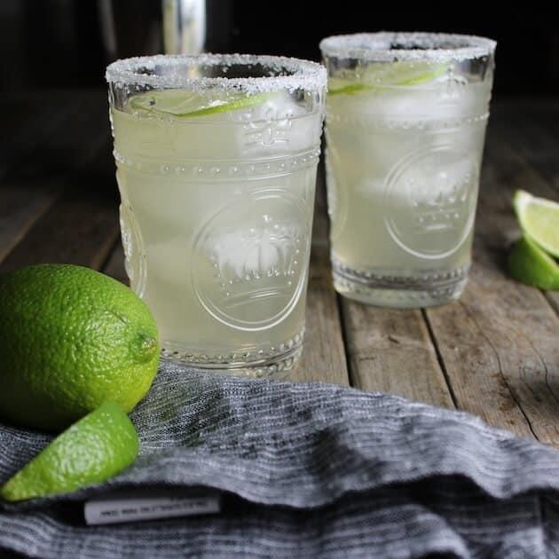 Two green St Germane Margaritas with salted rim