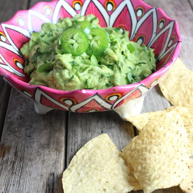 Eye level guacamole in decorative mexican serving bowl