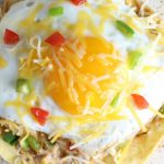 mexican pizza with refried beans and fried egg