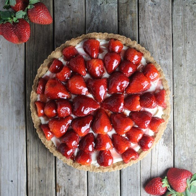 Tart with Strawberries and Mascarpone cheese on farm table