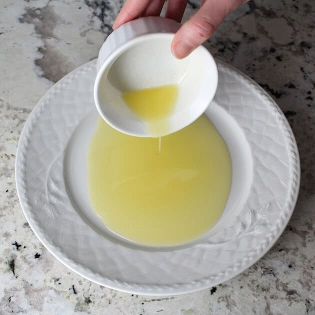 Adding melted butter to plate