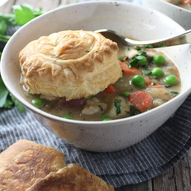 Bowl of Chicken Pot Pie Soup with puff pastry shell in the bowl