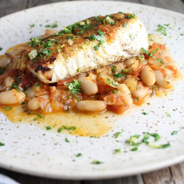Seared savory white Halibut filet with Beans And Gremolata