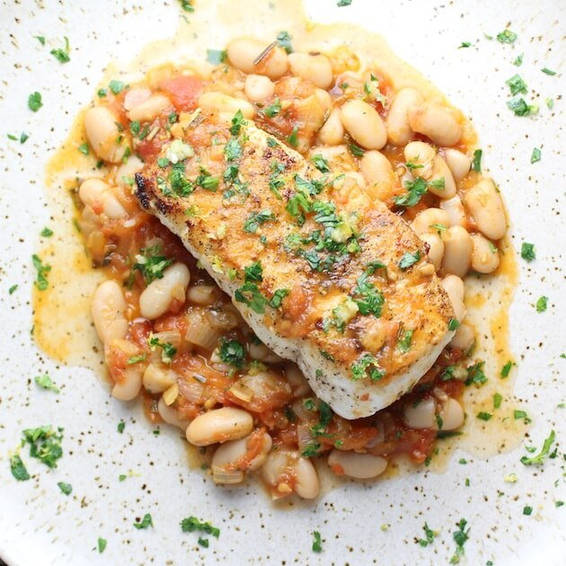 Halibut With White Beans And Gremolata on a plate