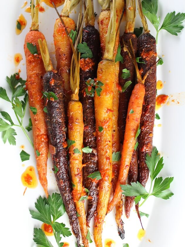 Honey Harissa Rainbow Carrots with harissa on platter