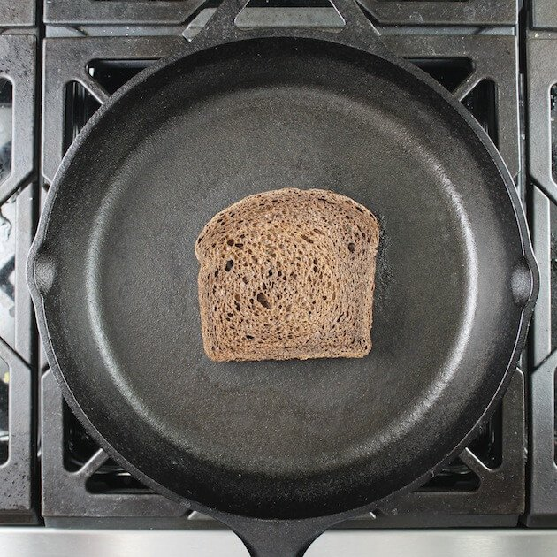 Toasting Pumpernickel bread in cast iron skillet