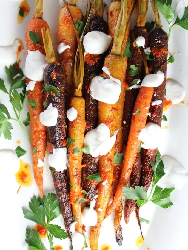 Rainbow Carrots on a platter with yogurt sauce