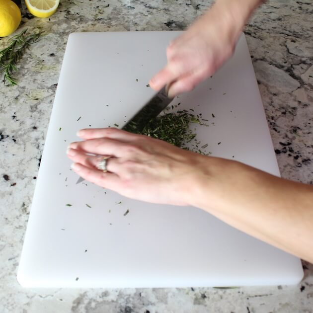 Chopping herbs on cutting board