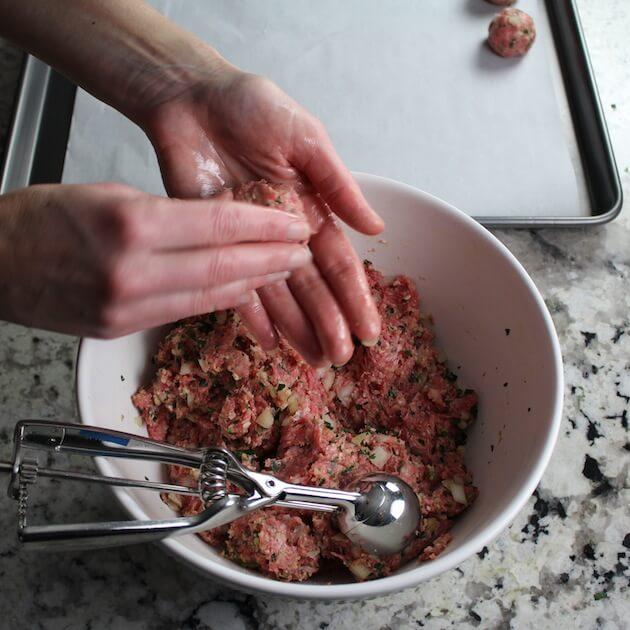 Shaping meatballs by hand before cooking