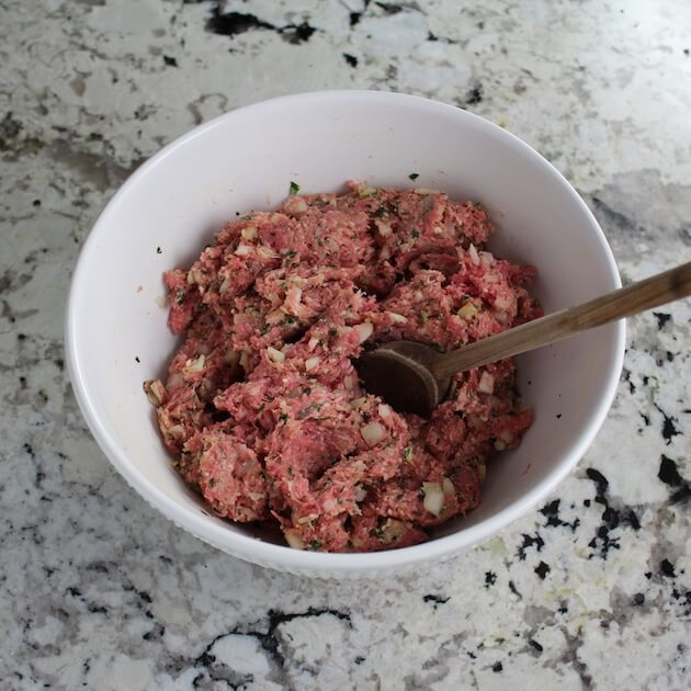 Meatball ingredients combined in mixing bowl