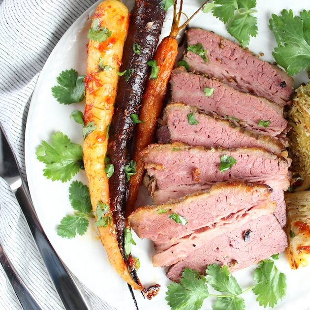 Sliced Corned Beef with carrots on plate