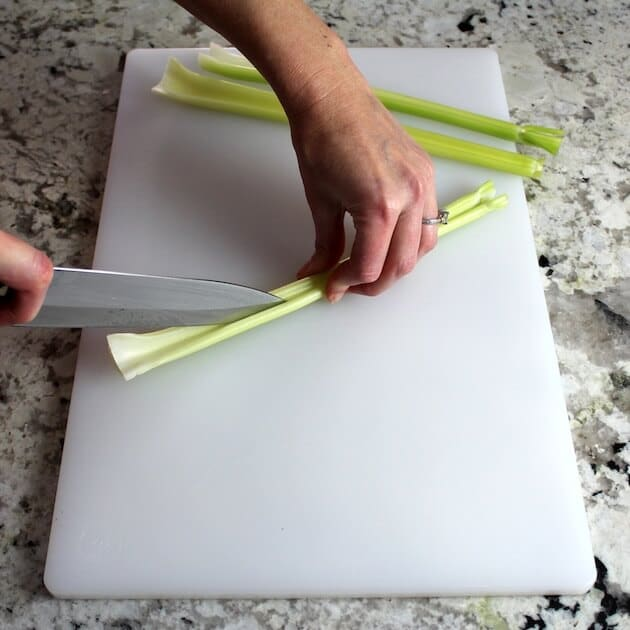 Slicing celery on cutting board