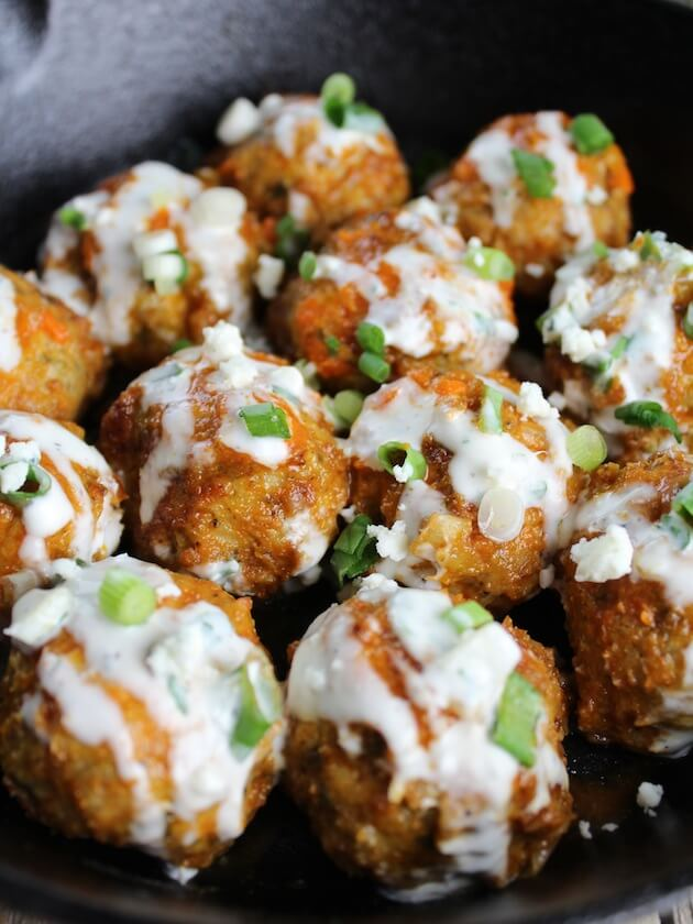 Close up of Buffalo Chicken Meatballs covered in sauce