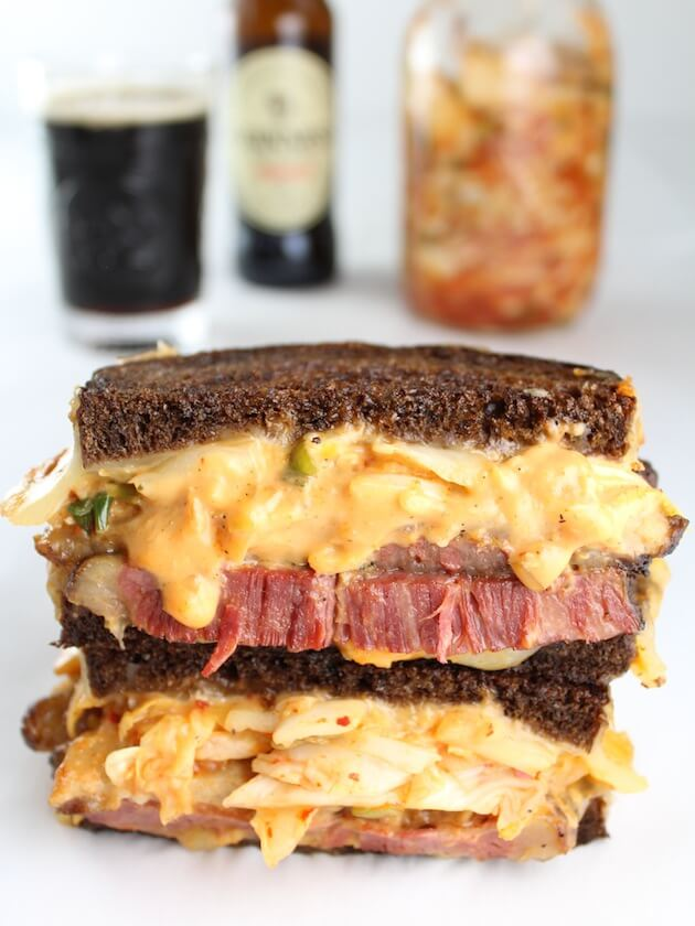 Stacked sandwich with corned beef and thousand island dressing on pumpernickel bread