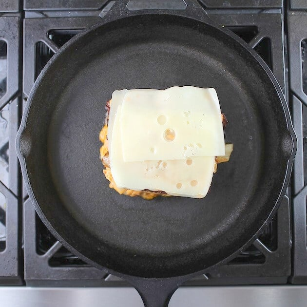 Adding swiss cheese layers to reuben sandwich on stovetop