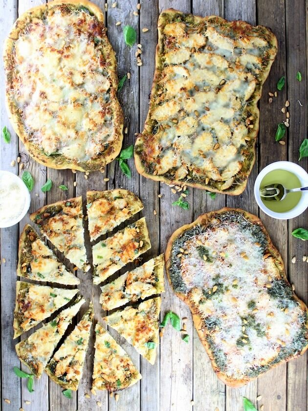 Four Chicken Pesto Pizzas on a farm table