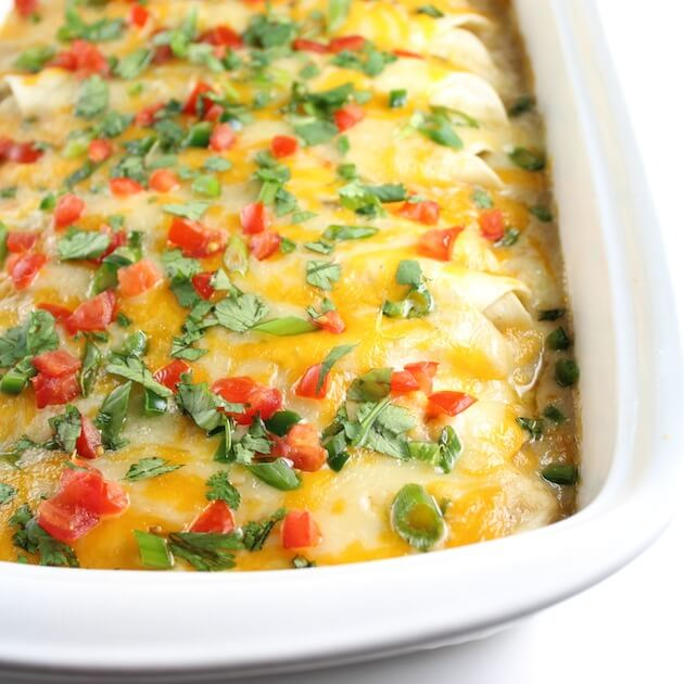 Partial Casserole dish of Enchiladas smothered in cheese