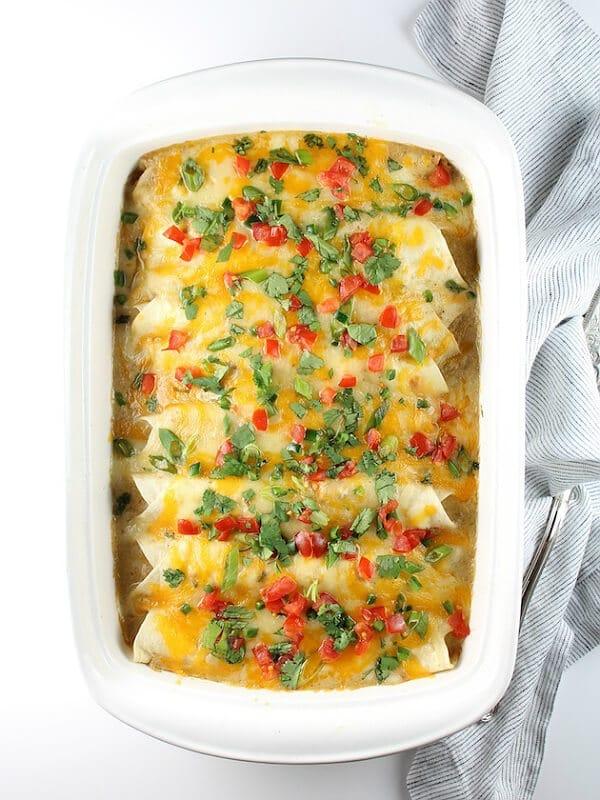 Casserole dish of cheesy chicken enchiladas