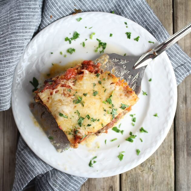Spatula on plate with a piece of Lasagna