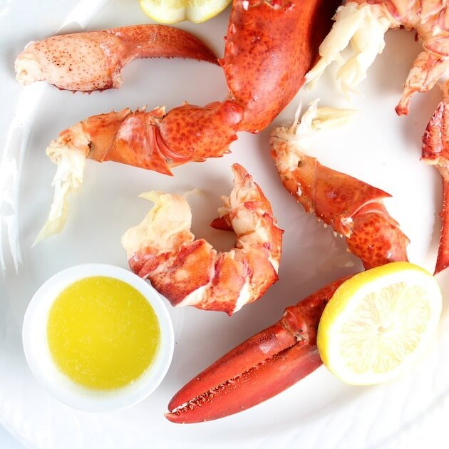 Platter with lobster shells, lobster meat, and drawn butter