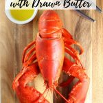bright red boiled lobster on cutting board