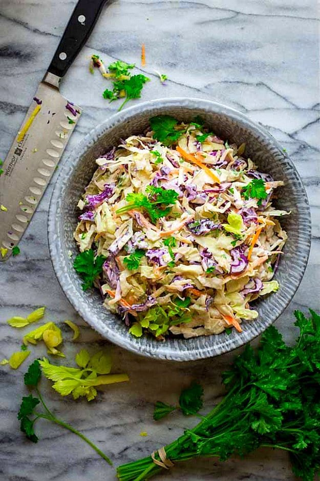 Coleslaw in a bowl on marble counter