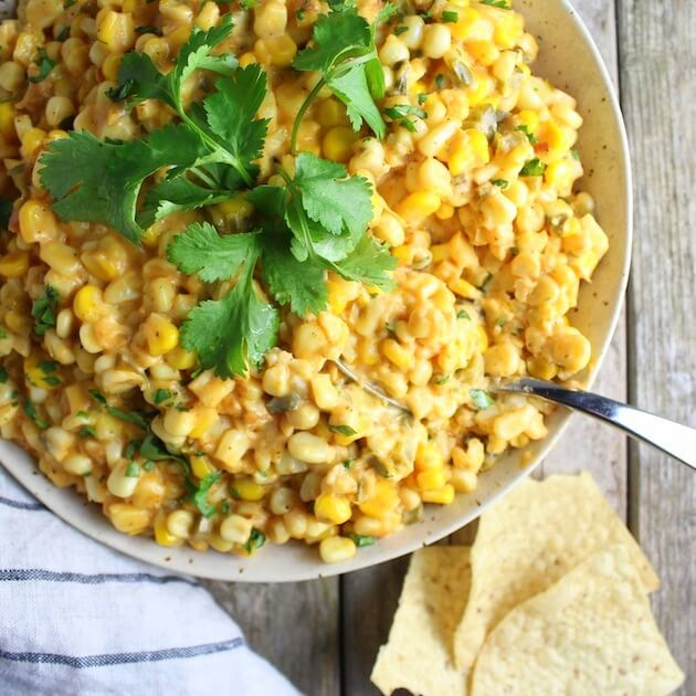 Creamy Cheesy Corn Dip in serving bowl with spoon
