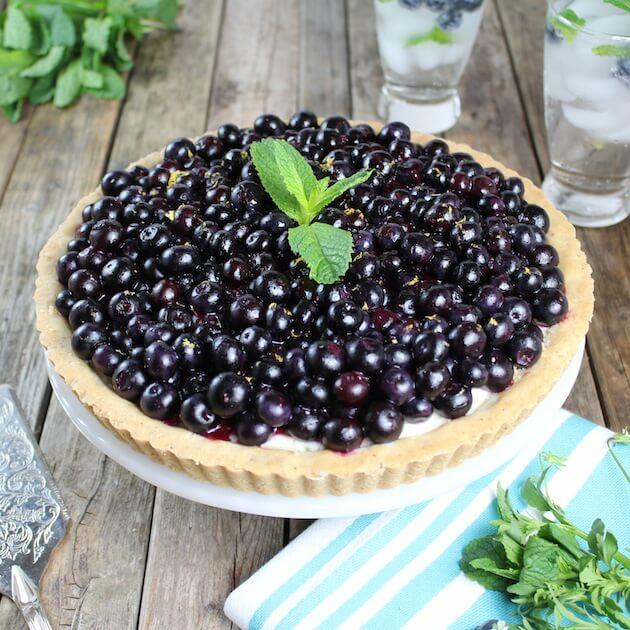 Summer Blueberry Mascarpone Tart on cake platter